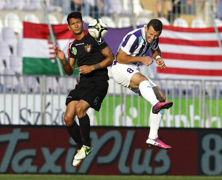 martinez: BUDAPEST - MAY 11: Air duel between Zoltan Szelesi of Ujpest (R) and Leandro Martinez of Honved during Ujpest vs. Honved OTP Bank League football match at Szusza Stadium on May 11, 2013 in Budapest, Hungary.