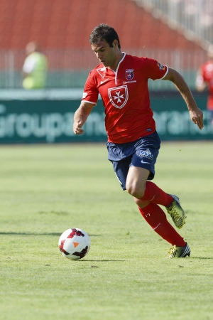 BUDAPEST - AUGUST 4  Nemanja Nikolic of Videoton runs with the ball before his first goal during FTC vs  Videoton OTP Bank League football match at Puskas Stadium on August 4, 2013 in Budapest, Hungary  Editorial