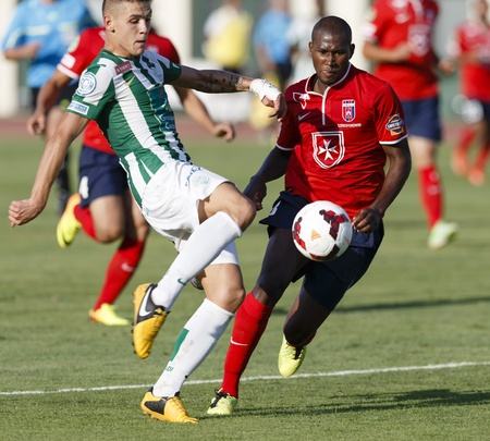 puskas: BUDAPEST - AUGUST 4  Muhamed Besic of FTC  L  shoots next to Paulo Vinicius of Videoton during FTC vs  Videoton OTP Bank League football match at Puskas Stadium on August 4, 2013 in Budapest, Hungary
