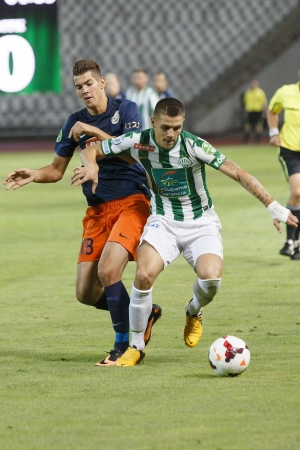puskas: BUDAPEST - AUGUST 17: Muhamed Besic of FTC (R) covers the ball from Barnabas Bese of MTK during FTC vs. MTK OTP Bank League football match at Puskas Stadium on August 17, 2013 in Budapest, Hungary.  Editorial