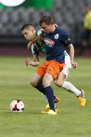 BUDAPEST - AUGUST 17: Duel between Muhamed Besic of FTC (L) and Tibor Ladanyi of MTK during FTC vs. MTK OTP Bank League football match at Puskas Stadium on August 17, 2013 in Budapest, Hungary.