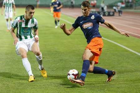 barnabas: BUDAPEST - AUGUST 17: Muhamed Besic of FTC (L) watches  the dribbling of Barnabas Bese of MTK during FTC vs. MTK OTP Bank League football match at Puskas Stadium on August 17, 2013 in Budapest, Hungary.  Editorial