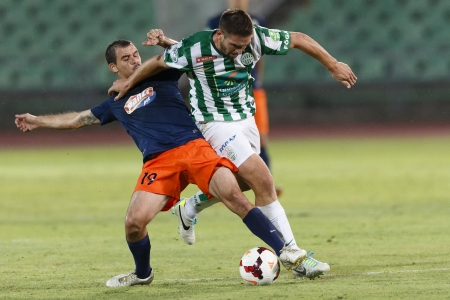 BUDAPEST - AUGUST 17: Daniel Bode of FTC (R) is tackled by Jozsef Kanta of MTK during FTC vs. MTK OTP Bank League football match at Puskas Stadium on August 17, 2013 in Budapest, Hungary.