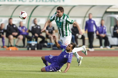 bode: BUDAPEST - SEPTEMBER 22: Daniel Bode of FTC (L) is tackled by Lucien Ngawa of UTE during Ferencvaros vs. Ujpest OTP Bank League football match at Puskas Stadium on September 22, 2013 in Budapest, Hungary.  Editorial