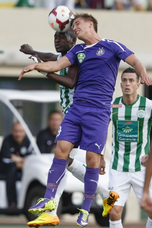BUDAPEST - SEPTEMBER 22: Air bottle between Ulysse Diallo of FTC (L) and Balazs Balogh of UTE during Ferencvaros vs. Ujpest OTP Bank League football match at Puskas Stadium on September 22, 2013 in Budapest, Hungary.