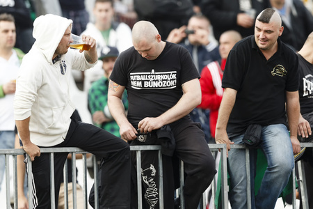 puskas: BUDAPEST - SEPTEMBER 22: Hooligans of FTC, one of them in a t-shirt with the text: The football-fans are not criminals during Ferencvaros vs. Ujpest OTP Bank League football match at Puskas Stadium on September 22, 2013 in Budapest, Hungary.
