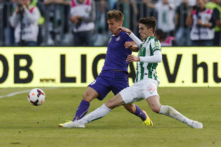 puskas: BUDAPEST - SEPTEMBER 22: David Holman of FTC (R) and Balazs Balogh of UTE fight for the ball during Ferencvaros vs. Ujpest OTP Bank League football match at Puskas Stadium on September 22, 2013 in Budapest, Hungary.