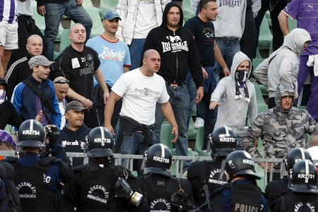 provocation: BUDAPEST - SEPTEMBER 22: Hooligans of UTE provocate the policemen during Ferencvaros vs. Ujpest OTP Bank League football match at Puskas Stadium on September 22, 2013 in Budapest, Hungary.