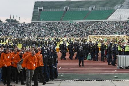puskas: BUDAPEST - SEPTEMBER 22: Hooligans of FTC break onto the pitch during Ferencvaros vs. Ujpest OTP Bank League football match at Puskas Stadium on September 22, 2013 in Budapest, Hungary.