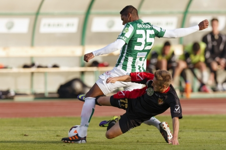 puskas: BUDAPEST - OCTOBER 6: Gerson of FTC (L) is tackled by Gergo Nagy of Honved during FTC vs. Honved OTP Bank League match at Puskas Stadium on October 6, 2013 in Budapest, Hungary.  Editorial