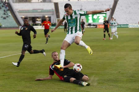 puskas: BUDAPEST - OCTOBER 6: Julian Jenner of FTC (R) is tackled by Aleksandar Ignjatovic of Honved during FTC vs. Honved OTP Bank League match at Puskas Stadium on October 6, 2013 in Budapest, Hungary.  Editorial