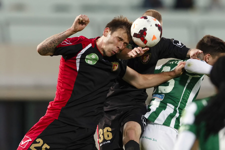 puskas: BUDAPEST - OCTOBER 6: Ivan Lovric of Honved heads the ball during FTC vs. Honved OTP Bank League match at Puskas Stadium on October 6, 2013 in Budapest, Hungary.