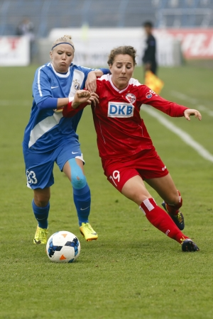 lilla: BUDAPEST - OCTOBER 10: Lilla Nagy of MTK (L) tries to stop Antonia Goransson of Potsdam during MTK vs. Potsdam football match at Hidegkuti Stadium on October 10, 2013 in Budapest, Hungary.