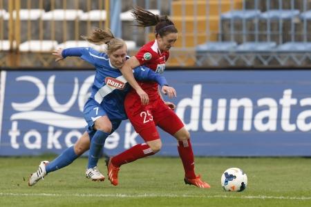 BUDAPEST - OCTOBER 10: Duel between Henrietta Csiszar of MTK (L) and Lisa Evans of Potsdam during MTK vs. Potsdam football match at Hidegkuti Stadium on October 10, 2013 in Budapest, Hungary.