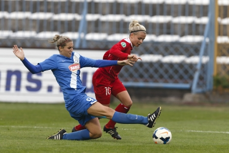 BUDAPEST - OCTOBER 10: Reka Demeter of MTK (L) tries to slide against Julia Simic of Potsdam during MTK vs. Potsdam football match at Hidegkuti Stadium on October 10, 2013 in Budapest, Hungary.