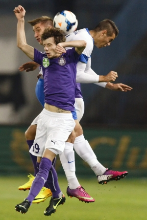 barnabas: BUDAPEST - OCTOBER 25: Air bottle between Barnabas Bese of MTK (R), Asmir Suljic (99) and Balazs Balogh of UTE during MTK vs. Ujpest OTP Bank League match at Hidegkuti Stadium on October 25, 2013 in Budapest, Hungary.  Editorial