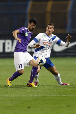 barnabas: BUDAPEST - OCTOBER 25: Duel between Barnabas Bese of MTK (R) and Jose Samper of UTE during MTK vs. Ujpest OTP Bank League match at Hidegkuti Stadium on October 25, 2013 in Budapest, Hungary.