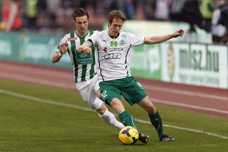 BUDAPEST, HUNGARY - MARCH 2, 2014: Michal Svec of Gyor covers the ball from Philipp Bonig of Ferencvaros (l) during Ferencvaros vs. Gyori ETO OTP Bank League football match at Puskas Stadium on March 2, 2014 in Budapest, Hungary.