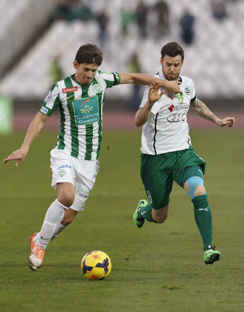 BUDAPEST, HUNGARY - MARCH 2, 2014: Duel between Zsolt Laczko of Ferencvaros (l) and Adam Dudas of Gyor during Ferencvaros vs. Gyori ETO OTP Bank League football match at Puskas Stadium on March 2, 2014 in Budapest, Hungary.