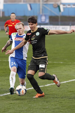 patrik: BUDAPEST, HUNGARY - MARCH 8, 2014: Patrik Poor of MTK (l) tries to stop Zsolt Laczko of Ferencvaros during MTK Budapest vs. Ferencvaros OTP Bank League football match at Hidegkuti Stadium on March 8, 2014 in Budapest, Hungary.