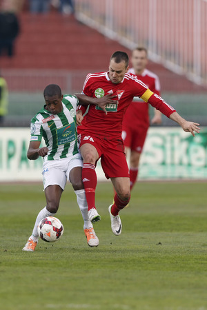 BUDAPEST, HUNGARY - MARCH 16, 2014: Peter Szakaly of DVSC tries to stop Somalia of Ferencvaros (l) during Ferencvaros vs. Debreceni VSC OTP Bank League football match at Puskas Stadium on March 16, 2014 in Budapest, Hungary.