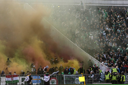 BUDAPEST, HUNGARY - MARCH 16, 2014: Supporters of Ferencvaros explode smoke bombs during Ferencvaros vs. Debreceni VSC OTP Bank League football match at Puskas Stadium on March 16, 2014 in Budapest, Hungary.