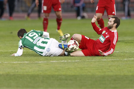 BUDAPEST, HUNGARY - MARCH 16, 2014:Selim Bouadla of DVSC commits a foul against Gabor Gyomber of Ferencvaros (l)  during Ferencvaros vs. Debreceni VSC OTP Bank League football match at Puskas Stadium on March 16, 2014 in Budapest, Hungary.  Editorial