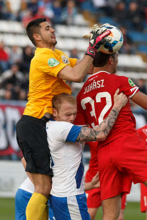 patrik: BUDAPEST, HUNGARY - MARCH 22, 2014: Lajos Hegedus of MTK (l) stops a cross next to Patrik Poor during MTK Budapest vs. Videoton OTP Bank League football match at Hidegkuti Stadium on March 22, 2014 in Budapest, Hungary.