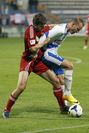 pal: BUDAPEST, HUNGARY - APRIL 12, 2014: Duel between Zsolt Horvath of MTK (r) and Pal Lazar of DVSC during MTK vs. Debreceni VSC OTP Bank League football match at Hidegkuti Stadium on April 12, 2014 in Budapest, Hungary.