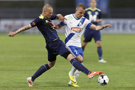 BUDAPEST, HUNGARY - MAY 9, 2014: Duel between Zsolt Horvath of MTK (r) and Gergo Vaszicsku of Puskas Academy during MTK vs. Puskas Academy OTP Bank League football match at Hidegkuti Stadium on May 9, 2014 in Budapest, Hungary.