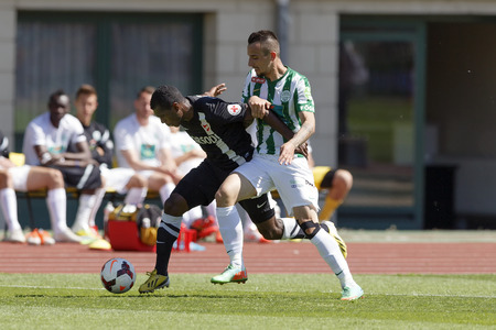 puskas: BUDAPEST, HUNGARY - MAY 10, 2014: Roland Ugrai of Ferencvaros (r) tries to tackle Augusto Batioja of Diosgyor during Ferencvaros vs. Diosgyori VTK OTP Bank League football match at Puskas Stadium on May 10, 2014 in Budapest, Hungary.  Editorial