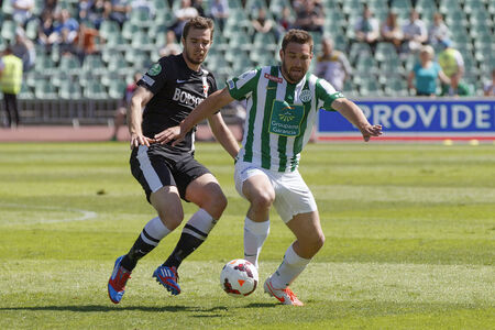 BUDAPEST, HUNGARY - MAY 10, 2014: Duel between Daniel Bode of Ferencvaros (r) and Andras Debreceni of Diosgyor during Ferencvaros vs. Diosgyori VTK OTP Bank League football match at Puskas Stadium on May 10, 2014 in Budapest, Hungary.
