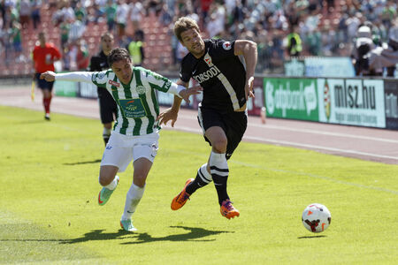 BUDAPEST, HUNGARY - MAY 10, 2014: Duel between Vladan Cukic of Ferencvaros (l) and Marko Futacs of Diosgyor during Ferencvaros vs. Diosgyori VTK OTP Bank League football match at Puskas Stadium on May 10, 2014 in Budapest, Hungary.