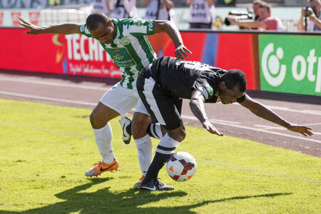 BUDAPEST, HUNGARY - MAY 10, 2014: Augusto Batioja of Diosgyor is shoved away by Leonardo Santiago of Ferencvaros (l) during Ferencvaros vs. Diosgyori VTK OTP Bank League football match at Puskas Stadium on May 10, 2014 in Budapest, Hungary.  Editorial