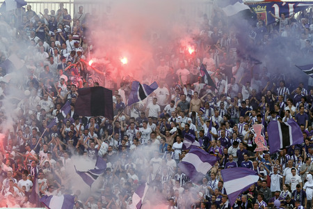 BUDAPEST, HUNGARY - MAY 25, 2014: Supporters of Ujpest during Ujpest vs. Diosgyori VTK Hungarian Cup final football match at Puskas Stadium on May 25, 2014 in Budapest, Hungary.