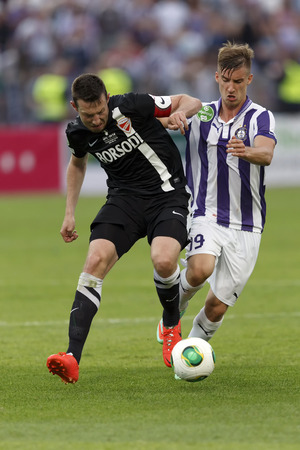 BUDAPEST, HUNGARY - MAY 25, 2014: Duel between Balazs Balogh of Ujpest (r) and Akos Elek of DVTK during Ujpest vs. Diosgyori VTK Hungarian Cup final football match at Puskas Stadium on May 25, 2014 in Budapest, Hungary.