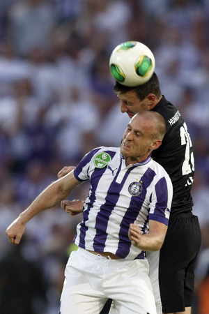 BUDAPEST, HUNGARY - MAY 25, 2014: Air battle between Filip Stanisavljevic of Ujpest (l) and Akos Elek of DVTK during Ujpest vs. Diosgyori VTK Hungarian Cup final football match at Puskas Stadium on May 25, 2014 in Budapest, Hungary.