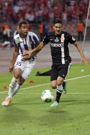 BUDAPEST, HUNGARY - MAY 25, 2014: Duel between Pierre-Yves Ngawa of Ujpest (l) and Senad Husic of DVTK during Ujpest vs. Diosgyori VTK Hungarian Cup final football match at Puskas Stadium on May 25, 2014 in Budapest, Hungary.