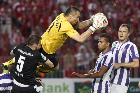 BUDAPEST, HUNGARY - MAY 25, 2014: Szabolcs Balajcza of Ujpest (m) saves beside Pierre-Yves Ngawa and Robert Litauszki (r) during Ujpest vs. Diosgyori VTK Hungarian Cup final football match at Puskas Stadium on May 25, 2014 in Budapest, Hungary.