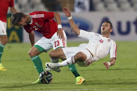 commits: BUDAPEST, HUNGARY - JUNE 4, 2014: Hungarian Balint Vecsei (l) commits a foul against Albanian Sokol Cikalleshi during Hungary vs. Albania friendly football match at Puskas Stadium on June 4, 2014 in Budapest, Hungary.  Editorial