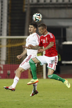 BUDAPEST, HUNGARY - JUNE 4, 2014: Air battle between Hungarian Roland Varga (r) and Albanian Elseid Hysaj during Hungary vs. Albania friendly football match at Puskas Stadium on June 4, 2014 in Budapest, Hungary.