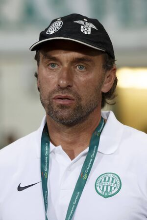BUDAPEST, HUNGARY - JULY 10, 2014: Head coach of FTC, Thomas Doll during Ferencvarosi TC vs. Sliema UEFA EL football match at Puskas Stadium on July 10, 2014 in Budapest, Hungary.  Editorial