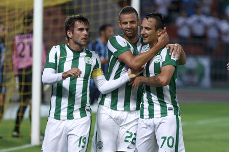 BUDAPEST, HUNGARY - JULY 10, 2014: Roland Ugrai of FTC (70) is celebrated by Gabor Gyomber (1) and Attila Busai during Ferencvarosi TC vs. Sliema UEFA EL football match at Puskas Stadium on July 10, 2014 in Budapest, Hungary.