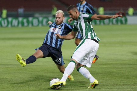 wanderers: BUDAPEST, HUNGARY - JULY 10, 2014: Paltemio Barbetti of Sliema (l) tries to block the cross of Attila Busai of FTC  during Ferencvarosi TC vs. Sliema UEFA EL football match at Puskas Stadium on July 10, 2014 in Budapest, Hungary.  Editorial