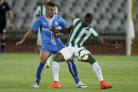 BUDAPEST, HUNGARY - JULY 24, 2014: Somalia of FTC (r) covers the ball from Josip Brezovec of Rijeka during Ferencvarosi TC vs. HNK Rijeka UEFA EL football match at Puskas Stadium on July 24, 2014 in Budapest, Hungary.  Sajtókép