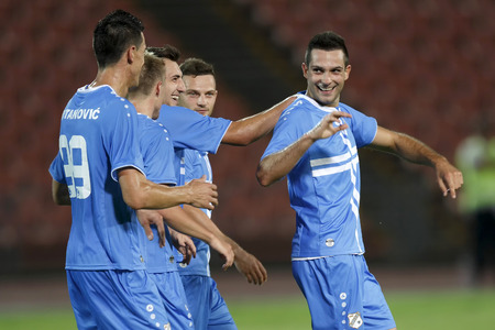 BUDAPEST, HUNGARY - JULY 24, 2014: Miral Samardzic (r) of Rijeka is celebrated after his goal during Ferencvarosi TC vs. HNK Rijeka UEFA EL football match at Puskas Stadium on July 24, 2014 in Budapest, Hungary.  Editorial