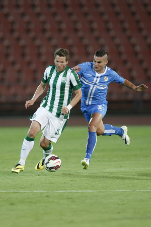 BUDAPEST, HUNGARY - JULY 24, 2014: Duel between Benjamin Lauth of FTC (r) and Josip Brezovec of Rijeka during Ferencvarosi TC vs. HNK Rijeka UEFA EL football match at Puskas Stadium on July 24, 2014 in Budapest, Hungary.
