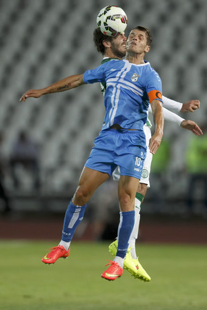 BUDAPEST, HUNGARY - JULY 24, 2014: Air battle between Gabor Gyomber of FTC (l) and Anas Sharbini of Rijeka during Ferencvarosi TC vs. HNK Rijeka UEFA EL football match at Puskas Stadium on July 24, 2014 in Budapest, Hungary.