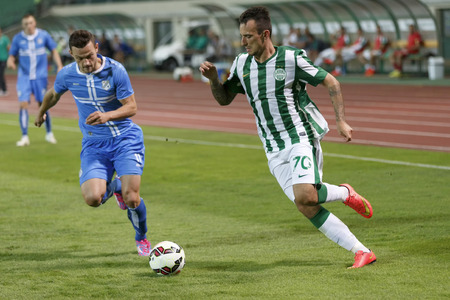 BUDAPEST, HUNGARY - JULY 24, 2014: Duel between Roland Ugrai of FTC (r) and Ivan Tomecak of Rijeka during Ferencvarosi TC vs. HNK Rijeka UEFA EL football match at Puskas Stadium on July 24, 2014 in Budapest, Hungary.