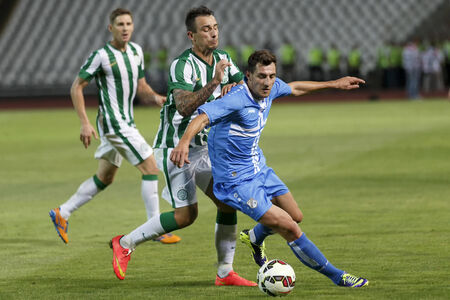 BUDAPEST, HUNGARY - JULY 24, 2014: Mato Jajalo of Rijeka covers the ball from Roland Ugrai of FTC (l) during Ferencvarosi TC vs. HNK Rijeka UEFA EL football match at Puskas Stadium on July 24, 2014 in Budapest, Hungary.  Editorial